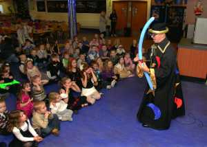 Children enjoying Wizzi Wizard at school presentation